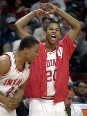 Indiana's Andre Owens (#20), right, and A.J. Moye,left, celebrate their win over the Wisconsin Badgers in March 2001.
