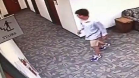 A surveillance video shows a man wandering inside the Greenville County Courthouse after breaking a window to get inside.