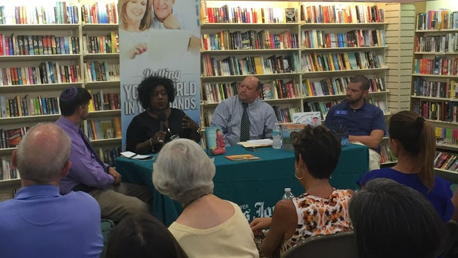 LaVonne Walker, restorative justice/practices coordinator for the Indian River County School District, speaks at a TCPalm pop-up conversation Oct. 9, 2017, at the Vero Beach Book Center. The conversation centered on how to speak to children about tolerance. She is joined on the panel by (from left) Rabbi Michael Birnholz, TCPalm's Laurence Reisman and the Rev. Michael York.