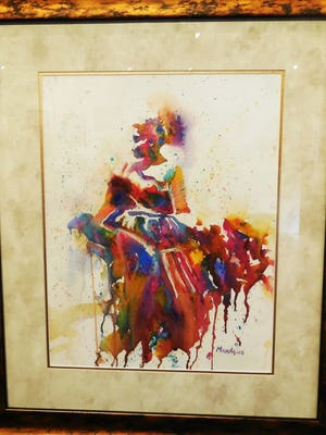 The Dancer, by Michelle Mariquez of Dixie Watercolor Society, shows high drama in her vivid painting.