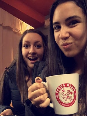 Cassidy DeStefano (right) and her friend Emily at the Wired Puppy, a coffee shop.