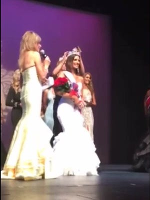 Melissa Brenny being crowned Mrs. Minnesota America on Saturday night in Bloomington