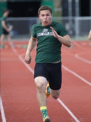 James Buchanan's Cormac Houpt runs the 100 during a