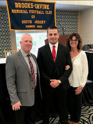 Vineland's Noach Sansalone (center) was honored as a scholar-athlete by the Brooks-Irvine Memorial Football Club of South Jersey. He is flanked by his mother, Amy, and coach Dan Russo.