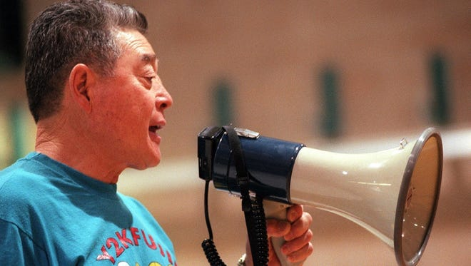 Ken Fujii directs operations during his basketball camp in 2000.