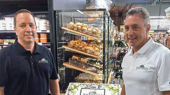 Flashback to Ray and Tony Rastelli celebrating the 1st anniversary of Rastelli Market Fresh in Marlton.