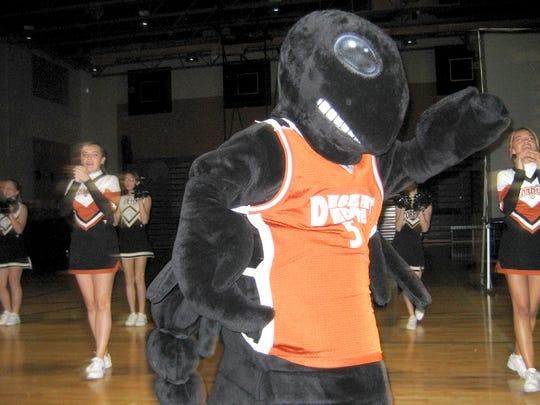 The Scopion dances with Desert Edge High School's cheerleaders at an open house for freshman in Goodyear, Az.