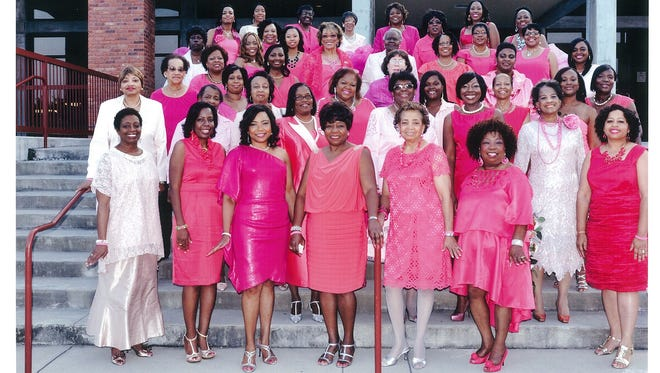 Members of the local AKA chapter on the steps of the â??Pink in the Cityâ? site at Sanders Beach-Corinne Jones Community Center.