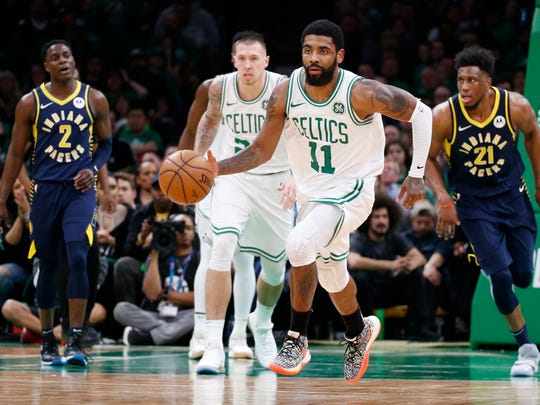 Apr 17, 2019; Boston, MA, USA; Boston Celtics guard Kyrie Irving (11) controls the ball during the second half in game two of the first round of the 2019 NBA Playoffs against the Indiana Pacers at TD Garden. Mandatory Credit: Greg M. Cooper-USA TODAY Sports