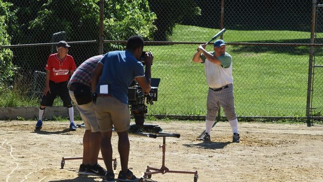 Stan Smilkstein, right, 68, of Hyde Park, stands up at bat during the filming of a documentary on senior softball at Spratt Park in the City of Poughkeepsie.