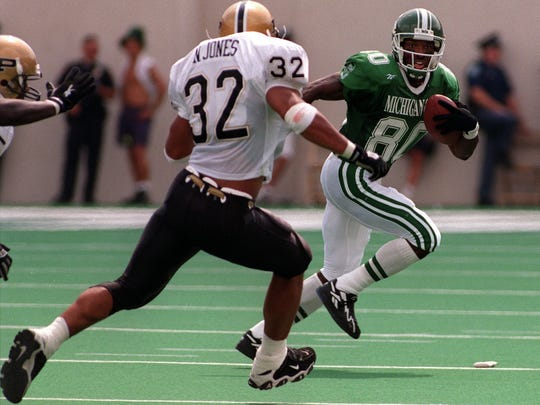MSU's Derrick Mason looks for a way around Noble Jones during the Spartan's game against the Boilermakers Saturday.