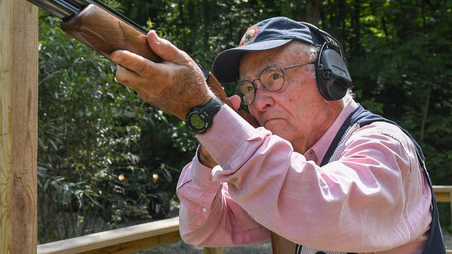 Canton native Joe Toot, Jr., 85, demonstrates how he readies to fire his shotgun at clay targets at Hill 'n Dale Club in Medina County. Toot has had a lifelong passion for sporting clays. He competes nationally and internationally, although COVID-19 has slowed his travel schedule this year.