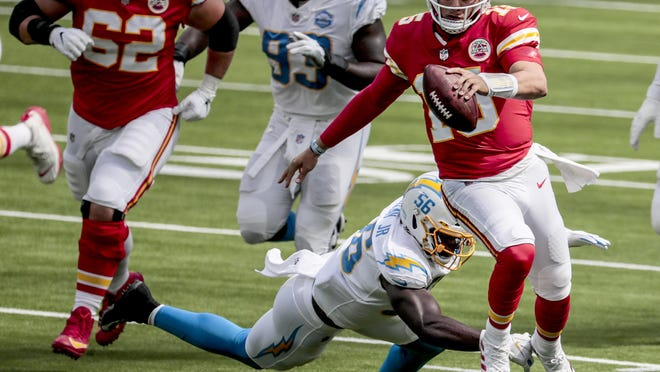 Linebacker Kenneth Murray (56) of the Los Angeles Chargers can't catch quarterback Patrick Mahomes (15) of the Kansas City Chiefs during second quarter action on Sunday, September 20, 2020 at SoFi Stadium in Inglewood, California.