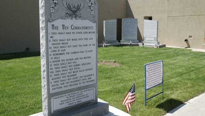 This May 15, 2012, photo shows the Bloomfield Ten Commandments monument at the City Hall in Bloomfield, N.M. An attorney for Bloomfield says the northwestern New Mexico city will consider whether to appeal a court ruling that the town's Ten Commandments monument violates the U.S. Constitution.