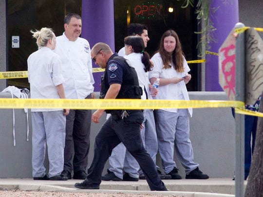 Police work at the scene of a shooting on March 18