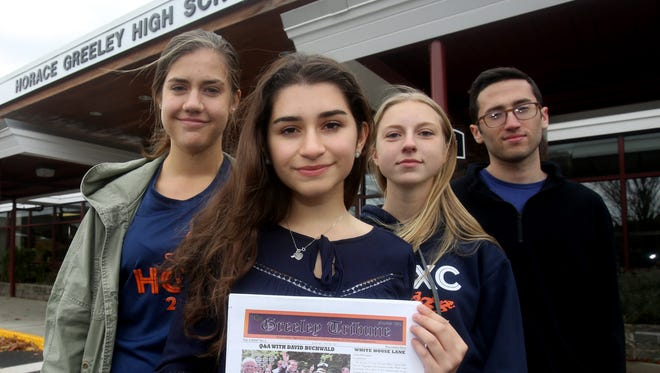 The editors of the Greeley Tribune, the student newspaper of Horace Greeley High School in Chappaqua, have endorsed Hillary Clinton for President. The school newspaper has never in its history endorsed a presidential candidate.  Meaghan Townsend, left, Amanda Cronin, Claire Hotchkin, editors in chief of the newspaper, and Billy Perlmutter, the paper's managing editor, were photographed Oct. 28, 2016.