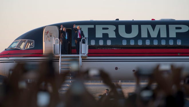 Donald Trump disembarks his campaign jet with New Jersey Gov. Chris Christie for a rally at Millington Regional Jetport on Feb 27, 2016.