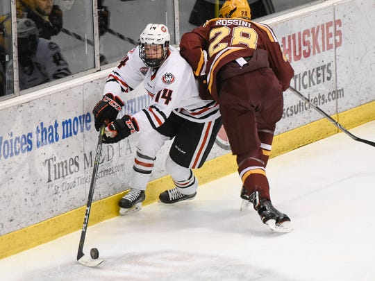 St. Cloud State's Patrick Newell skates with the puck