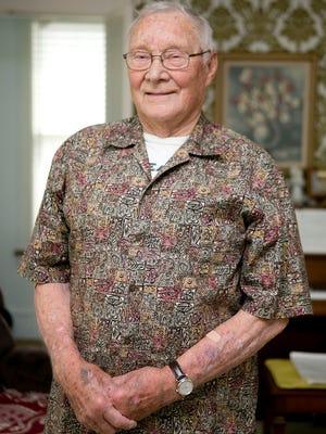Korean War veteran Richard Ashenbrener poses at his home in Wisconsin Rapids on Wednesday.