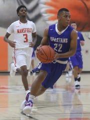 St. Peter's Tyson Kent runs the ball down the court at Mansfield Senior High School on Saturday night.