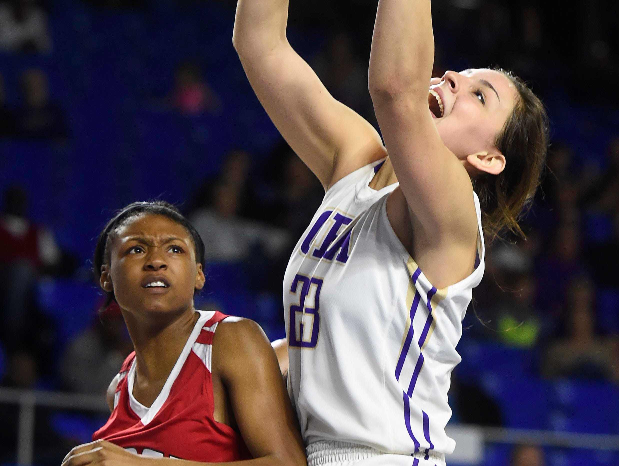 CPA's Savannah LeGate (23) grabs a rebound against East's Quentarra Mitchell (32) as East Nashville wins 47-35 in the Division I Class AA Girl's basketball tournament at the Murphy Center on MTSU's campus March 10, 2016 in Murfreesboro, Tenn.