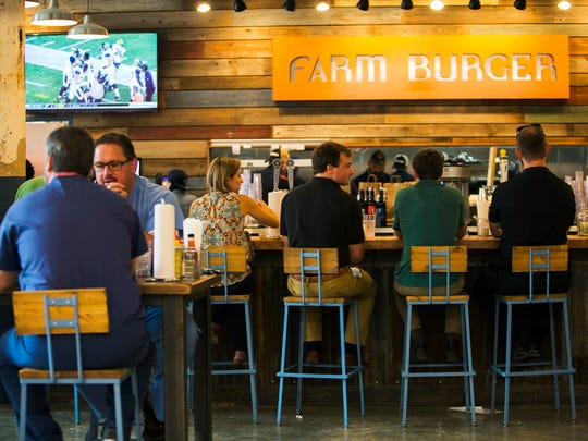 August 11, 2017 - Customers dine at Farm Burger Memphis in the new Crosstown Concourse. The restaurant has grass-fed and locally sourced burgers.