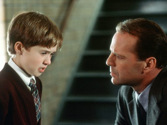 Haley Joel Osment (who sees dead people) and Bruce
