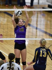 Lexington sophomore Allie Stoyko attempts to block a shot by  Ottawa-Glandorf in a Division II regional final at Ontario Saturday. Lexington will face next face the defending state champions as Chardon Notre Dame-Cathedral Latin returns to the volleyball Final Four.