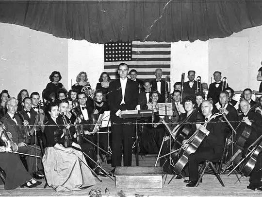 The full Vermont Symphony Orchestra performs in 1941 in Bennington. The young orchestra's founder Alan Carter appears the podium.