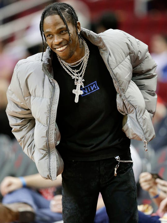 Hip hop artist Travis Scott watches warmups before an NBA basketball game between the Houston Rockets and the Denver Nuggets, Friday, Feb. 9, 2018, in Houston. (AP Photo/Eric Christian Smith)