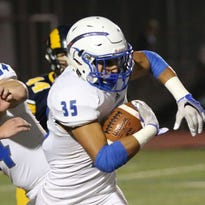 Brookfield Central running back Jaiden Banda finds running room after shaking a takle from Marquette's Jack Tarpey (35) when the two teams met in a huge Greater Metro clash Sept. 23.