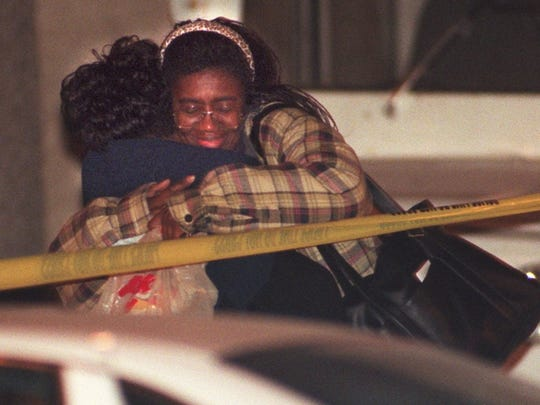 Two postal employees hug after they were released from the building at N. 4th St. and St Paul Ave. after an employee shot a killed a co-worker and wounded two others early Friday morning Dec. 19, 1997. The gunman later killed himself.