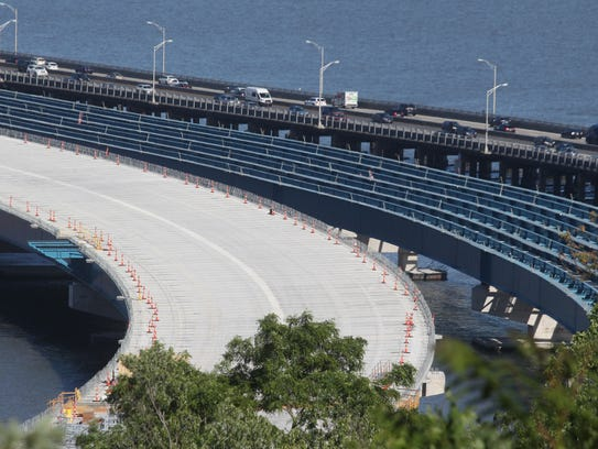 The northbound span of the new Tappan Zee bridge, left,
