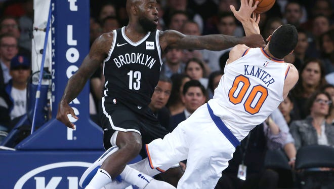 Oct. 3: Knicks center Enes Kanter, right, is fouled by Nets forward Quincy Acy during the first half at Madison Square Garden in New York.