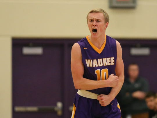 Waukee's Drew Johnson celebrates after a teammate scores during the Waukee at Johnston basketball game on Tuesday, Jan. 17, 2017, at Johnston High School. Waukee won in overtime, 64-57.