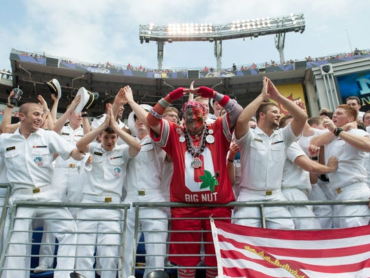 Aug 30, 2014; Baltimore, MD, USA; Jon Peters (center) stands with the Navy Midshipmen during the third quarter at M&T Bank Stadium. Ohio State Buckeyes defeated Navy Midshipmen 34-17.Mandatory Credit: Tommy Gilligan-USA TODAY Sports