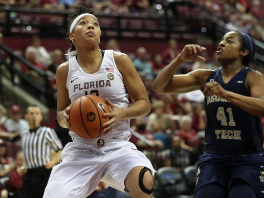 FSU's Nausia Woolfolk drives past Georgia Tech's Kierra Fletcher during their game at the Tucker Civic Center on Sunday, Feb. 25, 2018.