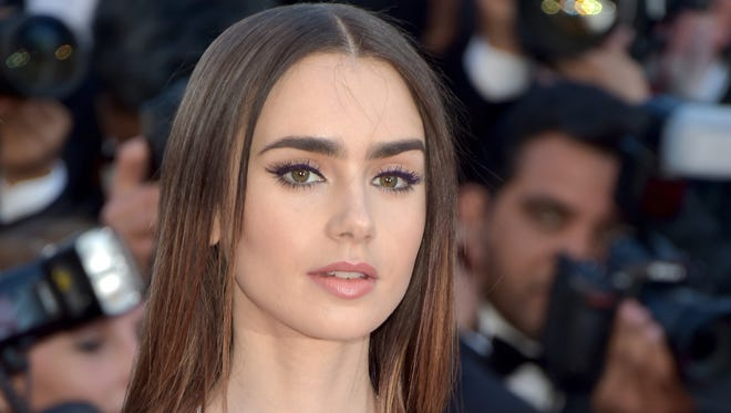Lily Collins, seen here at the 'Okja' premiere at Cannes, says magazine editors didn't want to use her when she was still rail-thin from 'To the Bone.'