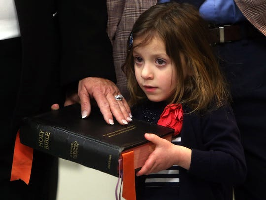 Freeholder Kathy DeFillippo got help from her 4-year-0ld granddaughter Colette DeFillippo as she was sworn in to a new term by Lt. Gov. Kim Guadagno in the Morris County Administration and Records building in Morristown. January 6, 2017, Morristown, NJ.