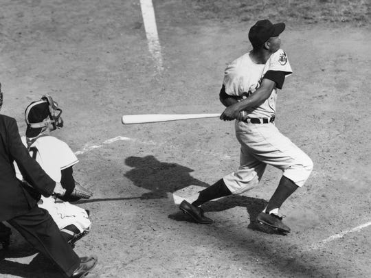 Cleveland Indians center fielder Larry Doby singles to right field in the fifth inning of World Series game opener at the Polo Grounds in New York, Sept. 29, 1954.