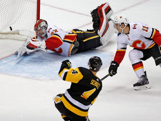 AP FLAMES PENGUINS HOCKEY S HKN USA PA