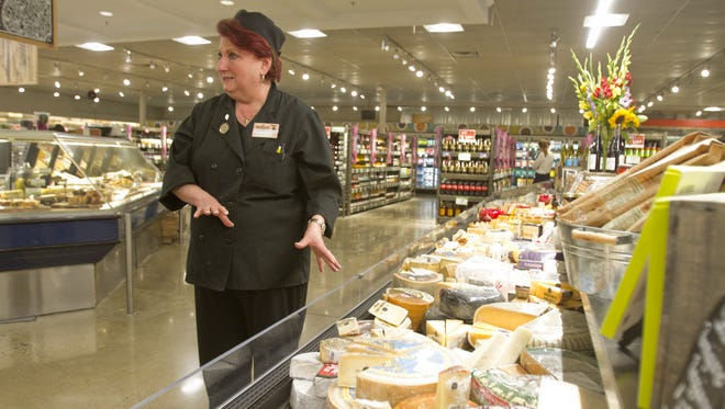 """Paula Larsen, Busch's Fresh Food Market's """"Goddess of Cheese,"""" is a certified cheese professional with the American Cheese Society who calls herself """"a little bit of a cheese snob."""" Larsen talks with the Livingston Daily Tuesday, July 18, 2017, before the Brighton store's grand opening."""
