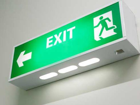 A green exit sign with arrow.