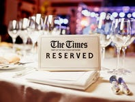 The Times Reserved sign on a table in restaurant