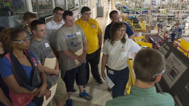 Recent high school graduates touring the Denso facility in Battle Creek.