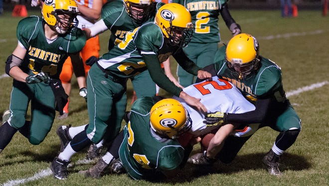 A group of Pennfield Panthers bring down Brody Froehlich of Dowagiac on the opening kick off.