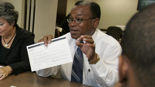Westchester Democratic Chairman and Election Commissioner Reginald LaFayette counting absentee ballots in 2007. Local state lawmakers said they will push to pass legislation that would bar party bosses from serving as commissioners.