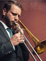 Trombone player Chad Fisher of Deatsville is a member