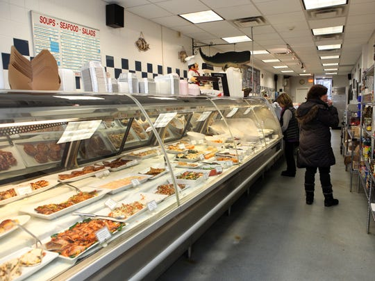 Prepared foods and fresh fish are available at Eastchester Fish Gourmet market in Scarsdale.