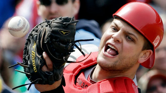 Cincinnati Reds catcher Devin Mesoraco can' t make the catch on a foul hit by Chicago Cubs' Starlin Castro during the first inning.